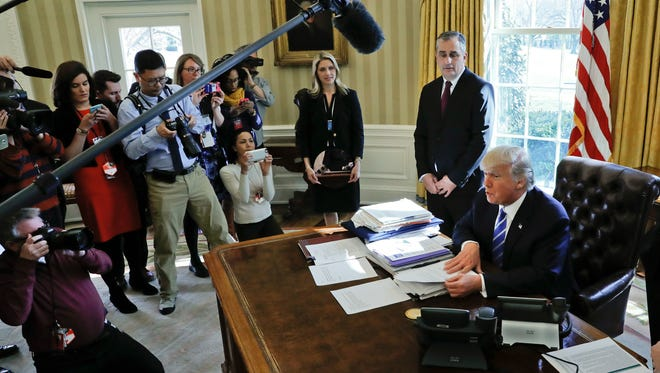 President Donald Trump, accompanied by Intel CEO Brian Krzanich, speaks to members of the media during a Feb. 8 meeting in the Oval Office of the White House.