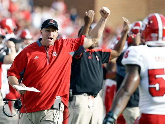 North Carolina State coach Dave Doeren reacts following
