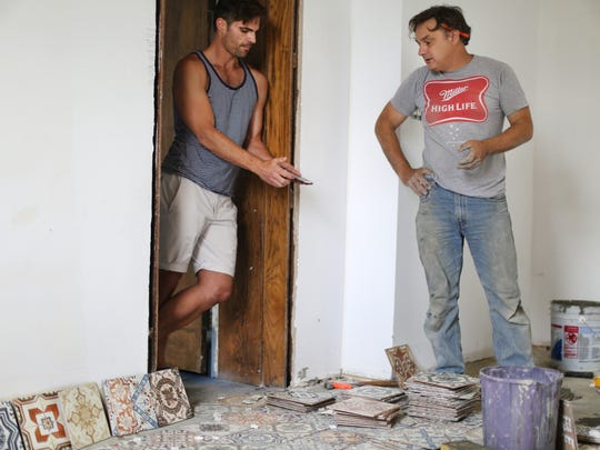 Jimmy Musuraca (left) talks with head contractor Billy VantWoud. The new tiles for the floor are imported from Portugal.