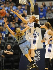 North Harrison's Lilly Hatton (center) blocks the shot