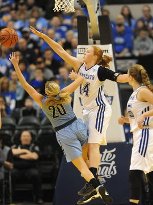 North Harrison's Lilly Hatton (center) blocks the shot of South Bend St. Joseph's Nicole Konieczny (20) on Saturday during the 2017 IHSAA 3A Girls State Championship game at Bakers Life Fieldhouse in Indianapolis. South Bend St. Joseph won 57-49. Feb. 25, 2017
