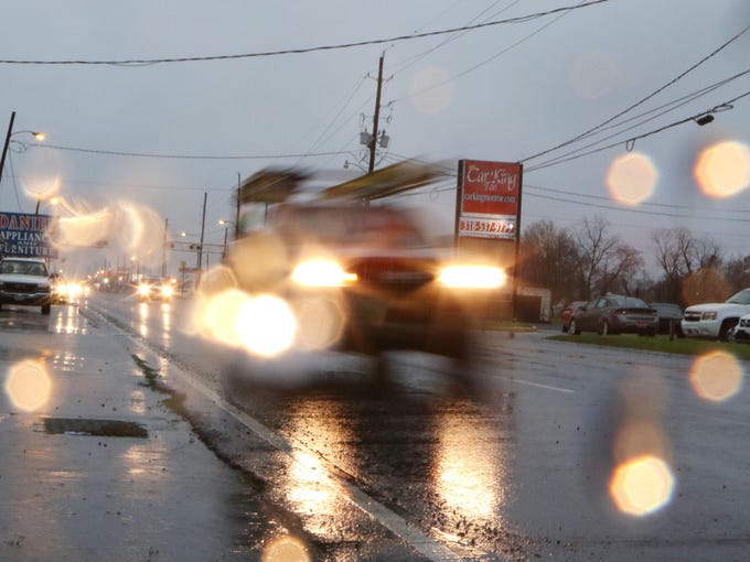 Traffic drives along Louisville Avenue in Monroe in