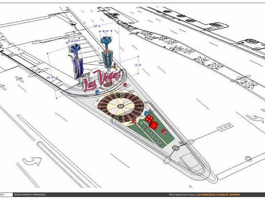 """A rendering of a new gateway art piece on the fork between Las Vegas Boulevard and Main Street. This section of sidewalk would include a roulette table with showgirl and """"City of Las Vegas"""" signs. It marks the entrance to downtown Las Vegas where Main Street stops at Las Vegas Boulevard on The Strip."""