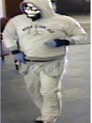Silver skull mask bank robber