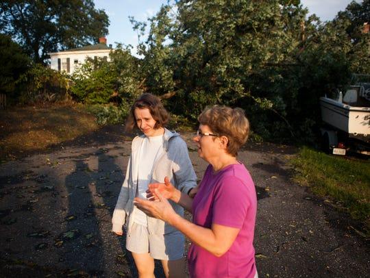 Cheryl Elliott, left, and her mom Jeannie Elliott talk