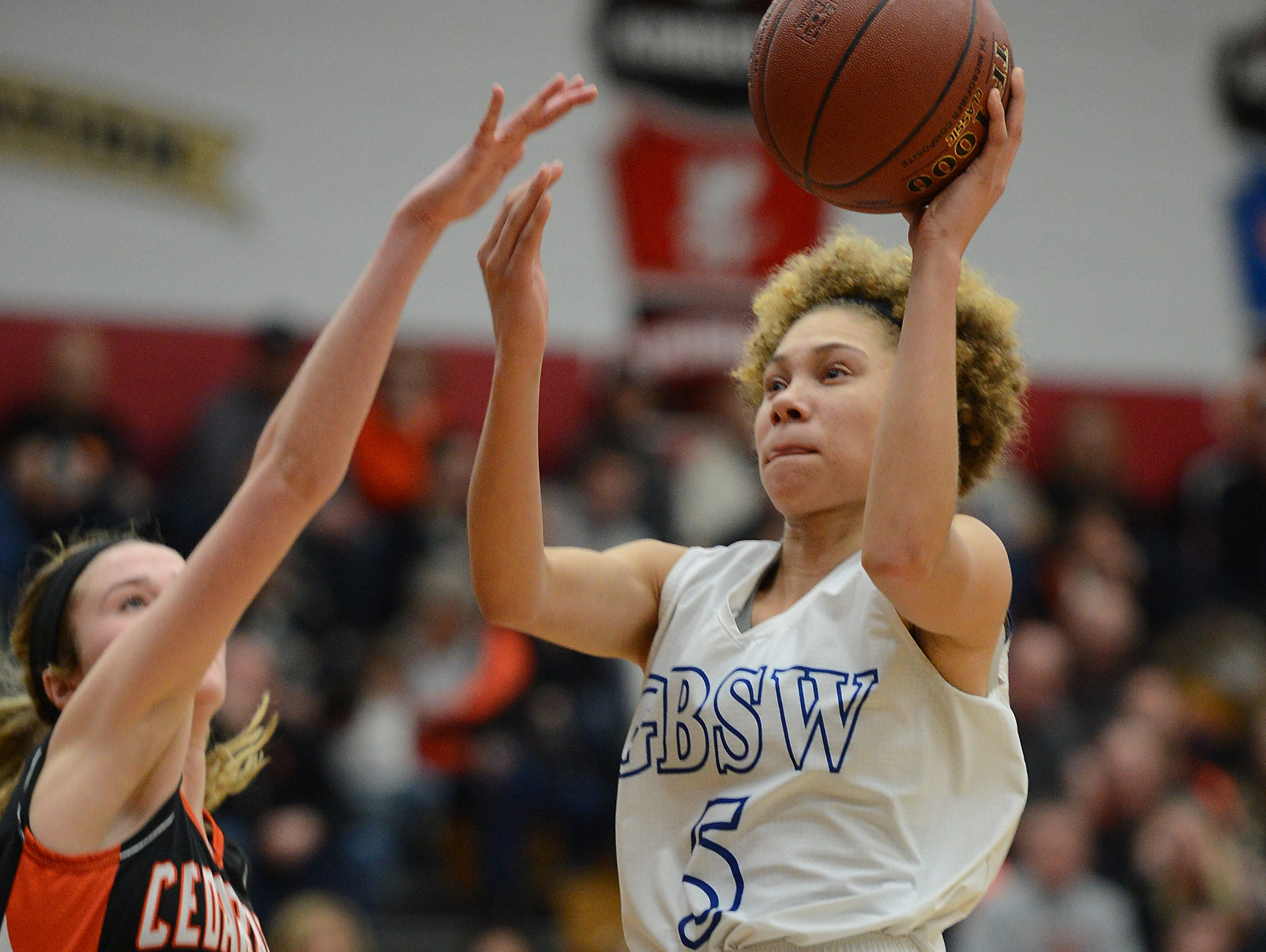 Green Bay Southwest HIgh School player Natisha Hiedeman (5) drives the lane in the D2 sectional finals against Cedarburg at Fond du Lac.