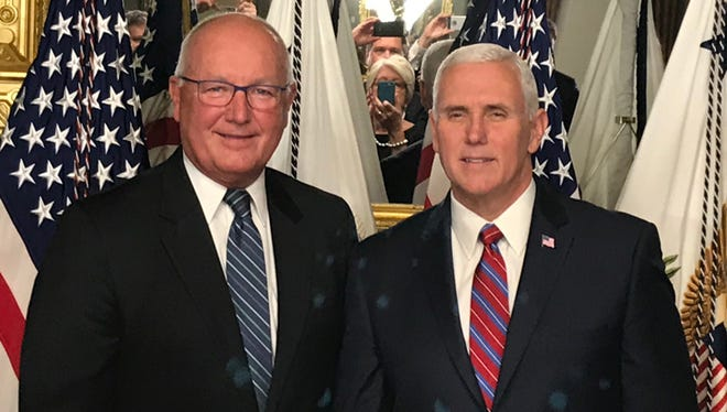 Former U.S. Rep. Pete Hoekstra of Michigan, left, and Vice President Mike Pence.