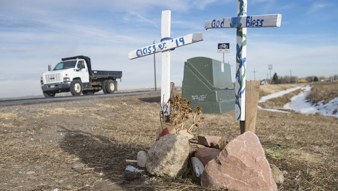 Traffic passes a pair of memorials for Kelly and Joshua Cortez near the intersection of Giddings Road and Richards Lake Road on Wednesday, January 3, 2018. The mother and her son were killed in a crash at the intersection in November.