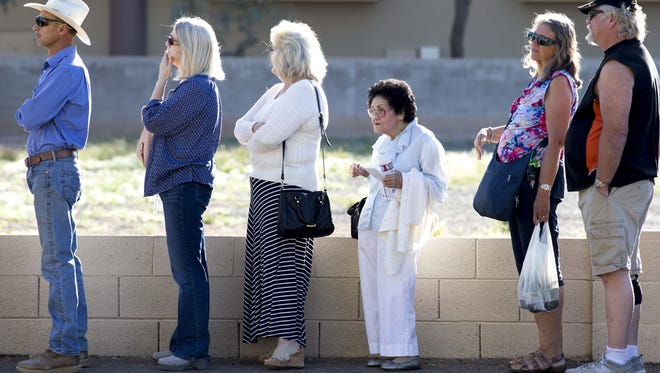 Voters wait in line at the American Legion Matthew B Juan Post 35 in Chandler.