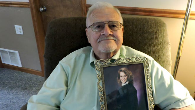 Chester (Chet) Szuber, 80, of Berkley, holds a photo of his daughter, Patti Szuber, on July, 15, 2016.