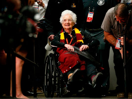 Loyola's Sister Jean Dolores Schmidt arrives at a news conference for the Final Four NCAA college basketball tournament, Friday, March 30, 2018, in San Antonio. (AP Photo/Brynn Anderson)