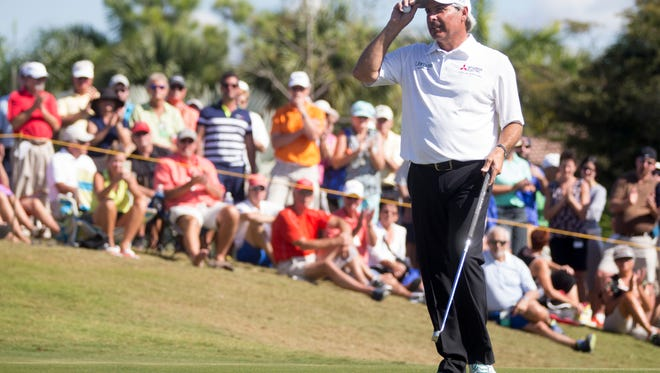 PGA Tour Pro Fred Couples acknowledges the crowds applause after sinking a putt on No. 9 during the final round of the Chubb Classic at TwinEagles Club Sunday, Feb. 19, 2017 in Naples.