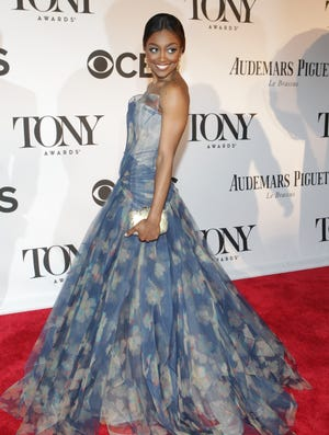 """Patina Miller: The winner for leading actress in a musical (""""Pippin"""") was a vision in a printed Zac Posen gown and 19th-century gold and diamond chandelier earrings and a 1960s enamel, diamond and gold snake bracelet by Fred Leighton. """"All I told him was I was I want to look fabulous and feel marvelous!"""" she said of her pre-carpet conversation with the designer. She also gushed about her experience working on """"Pippin"""": """"It's very special to me. I love being part of the revival and I love everyone that I work with. … To know that you struck something with the audience and that people love to come and see the show is amazing. It's a celebration of all of it. I have so many friends nominated and so many friends performing, it's a reunion!"""""""