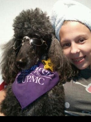 Betsy Eye and one of the therapy dogs during her many hospital stays.