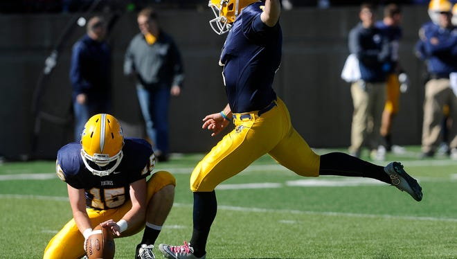 Augustana's #1 Lucas Wainman kicks the football for extra points against Wayne State during football action at Kirkeby-Over Stadium in Sioux Falls, SD; Saturday, Oct. 17, 2015.