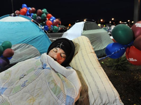 People waiting overnight brought tents, blankets and pillows to get some sleep while waiting in line for the Primanti Bros. opening in York Township.