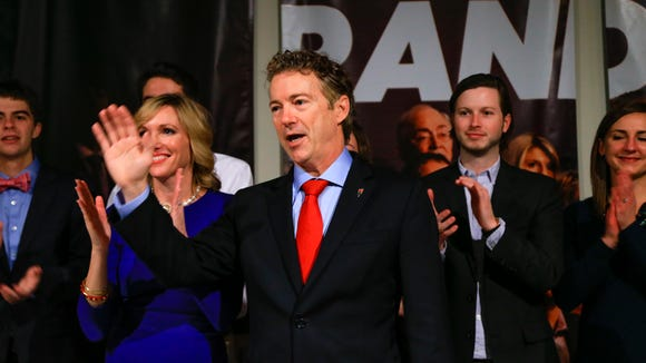 Sen. Rand Paul, R-Ky, waves to supporters with his