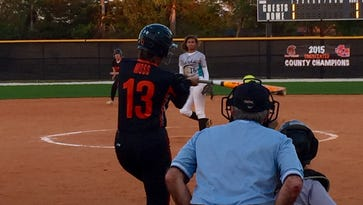 Lely's Katie Moss rips a two-run double in the first inning of Tuesday night's home game against Gulf Coast. Moss went 3 for 4 with a pair of doubles, but the Trojans lost 9-8 to the Sharks.