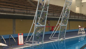 A nearly 15-foot climbing wall was unveiled Thursday at the pool inside Lansing's Alfreda Schmidt Southside Community Center.