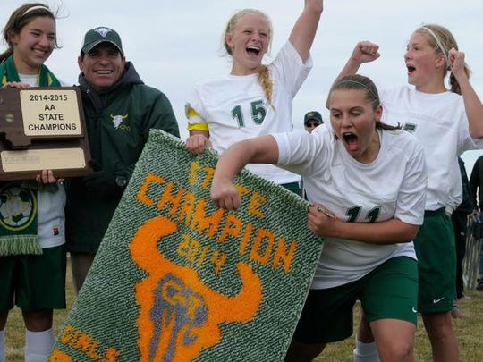 C.M. Russell girls' soccer coach Willie Pyette celebrates the 2014 Class AA championship.