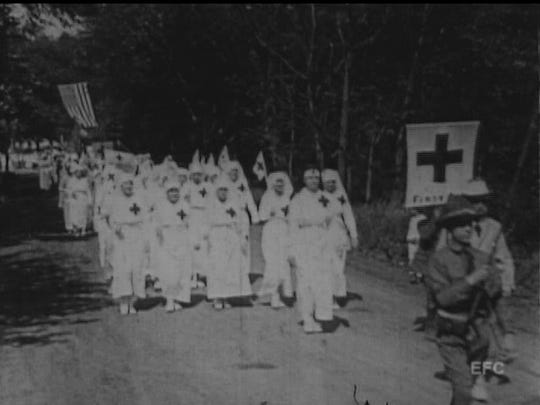 American Red Cross representatives march down Passaic Avenue in a Nutley parade, depicted in a rare 1918 film.