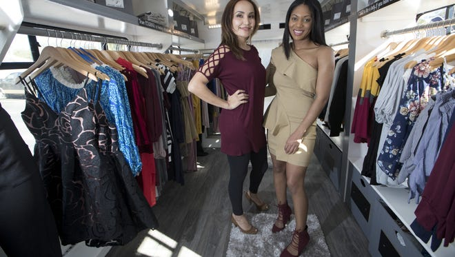 FAMU grad Chelse Collins, right, and working mom Manzura Ishanova stand inside their new mobile boutique called Novus Racks, a bus that has been transformed into a shopping experience.