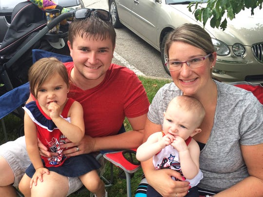 Kurtis Hartsock and his wife Chelsea attended the 4thFest parade in Coralville on Monday, July 4, 2016, with their daughters, Paityn, left, and Scarlett.