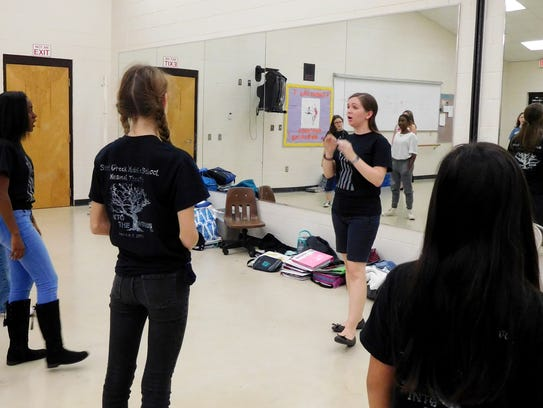 Jenilee Hallam takes students through vocal exercises.