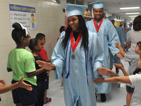 Hirschi High School Graduating Senior, Tanya Brown received a warm welcome from Burgess Elementary students Wednesday morning during her class' walkthrough to help encourage the students to make good grades.