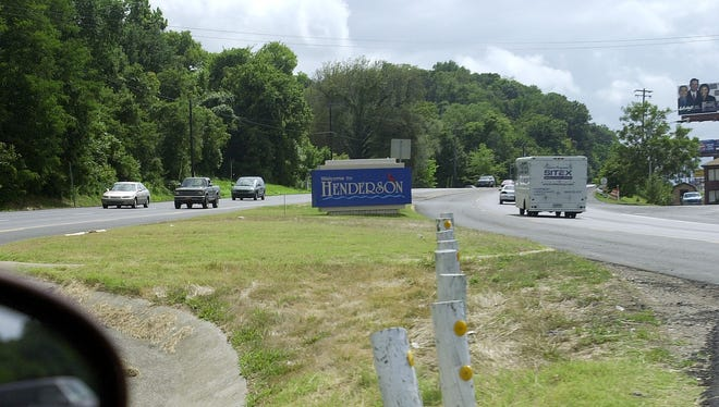 "With the ""Welcome to Henderson"" sign partially obstructing the view of oncoming traffic, a motorist turns onto  KY 414 (Wolf Hills Road) off of HWY 41 as seen from inside the car Wednesday afternoon, August 14, 2002.  (Gleaner photo by Darrin Phegley)"