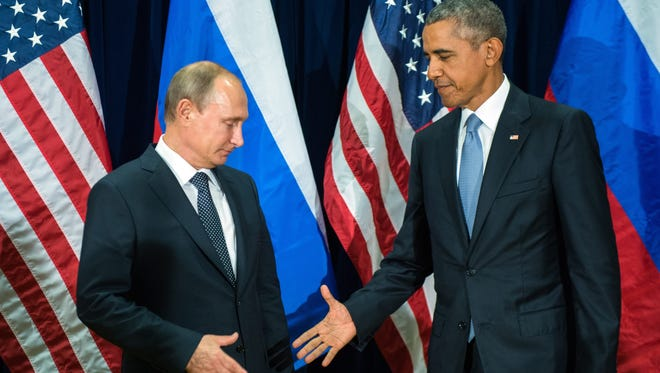 Russian President Valdimir Putin, left,  and U.S. President Barack Obama shake hands for the cameras before the start of a bilateral meeting at the United Nations headquarters in New York City.