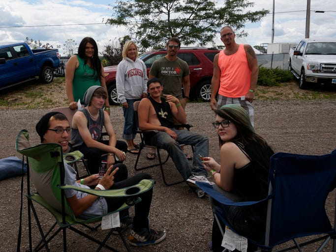 Many Rock USA attendees made themselves comfortable July 16 while waiting in line to get in.