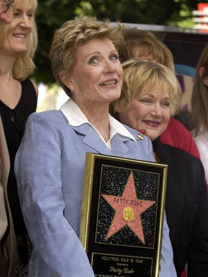 Actress Patty Duke attends a ceremony honoring her with a star on the Hollywood Walk of Fame in August  2004.