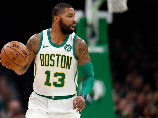 Nov 21, 2018; Boston, MA, USA; Boston Celtics forward Marcus Morris (13) controls the ball during the second half against the New York Knicks at TD Garden. Mandatory Credit: Greg M. Cooper-USA TODAY Sports