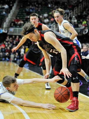 Waterford's Joe Clifford reaches for a loose ball and Powers' Bobby Kleinman, right, does also in the second half. Powers North won 59-48 to repeat as Class D champions.