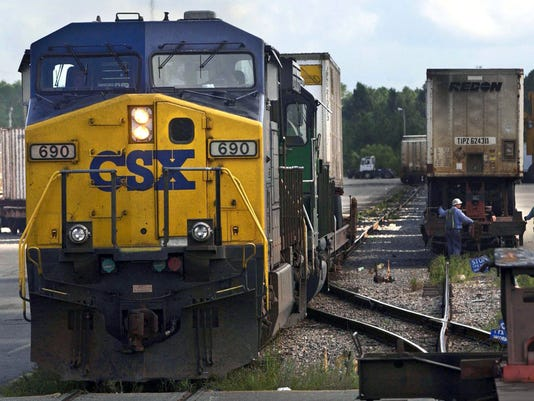 railroad company csx to lay off 1 000 in management