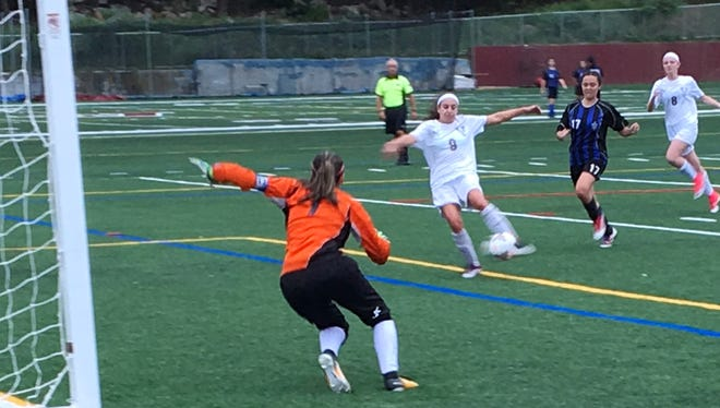 Junior Sarah Carlucci scores a goal with the goalie out of position against Science Park. It was Carlucci's first varsity hat trick.