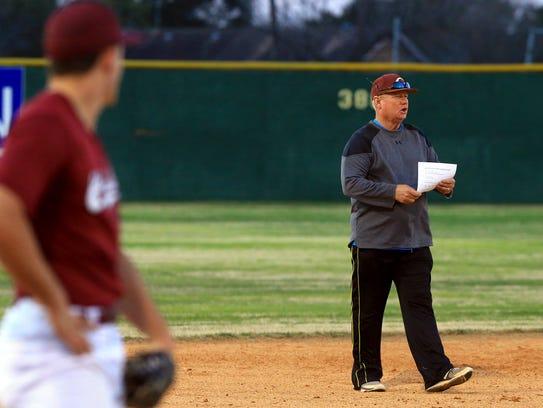 Calallen's head coach Steve Chapman talks to his players