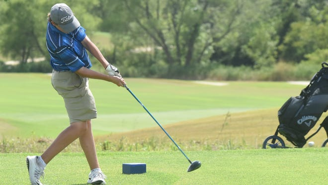 Mountain Home's Gaige Chaney tees off during first round action Monday at the Ultimate Auto Group Invitational at Big Creek Golf & Country Club.