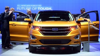 The new Ford Edge Sport attracts attention at the LA Auto Show's press and trade day in Los Angeles, California on November 19, 2014. Nearly 60 North American and World vehicle debuts will be unveiled at this years auto show which opens to the public from November 21 to 30. AFP PHOTO/Frederic J. BROWNFREDERIC J. BROWN/AFP/Getty Images ORG XMIT: 523842809 ORIG FILE ID: 535515560
