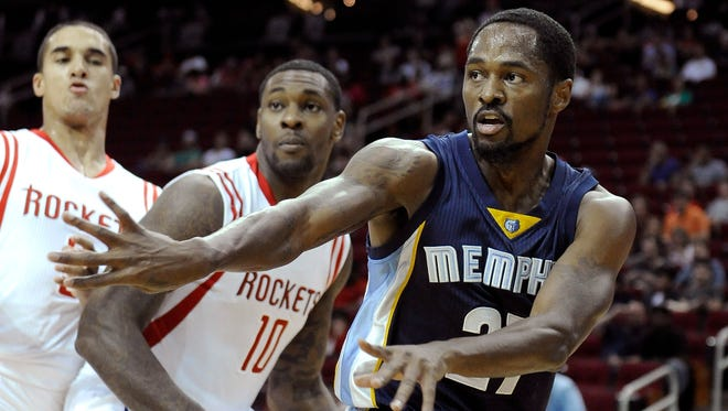 Memphis Grizzlies point guard Kalin Lucas passes the ball against the Houston Rockets on Oct. 9, 2014, in Houston.