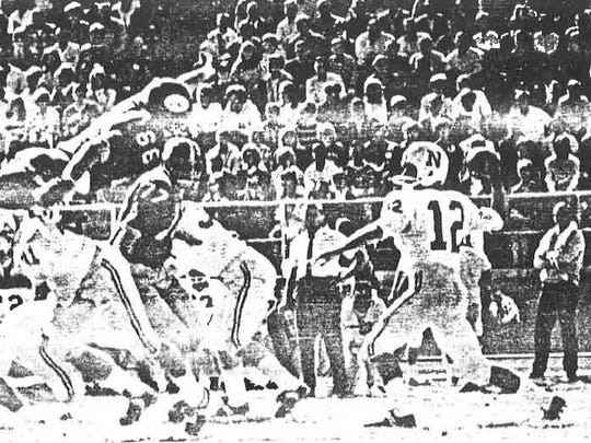Chris Ault throws a pass during one of the first games at New Mackay Stadium.
