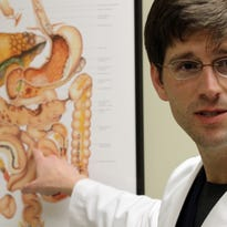 Christopher Herrington, M.D., talks to The Advertiser at Acadiana Gastroenterology Associates in Lafayette.