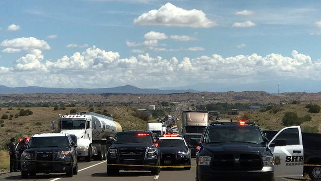This photo provided by the New Mexico State Police show the scene on Interstate 25 north of Albuquerque, N.M., Tuesday, July 25, 2017, where there was a shootout between an armed robbery suspect and law enforcement officers. Gunfire between the suspect and New Mexico officers left a stolen truck and police vehicles shot up with bullet holes but nobody was injured.