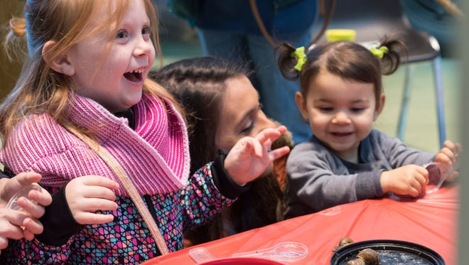 Bryn Paramore, 5, left, reacts to the garden snails and night crawlers on display at University of California Master Gardener's booth during the Tulare County Museum's annual Main Street Jamboree on Saturday, March 3, 2018. The Jamboree is a free community event to bring awareness to the museum at Mooney Grove Park.