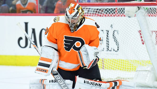 Philadelphia Flyers goalie Michal Neuvirth makes a save against the Toronto Maple Leafs during the first period at Wells Fargo Center.