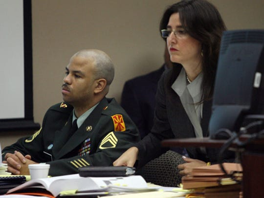 Former U.S. Army Staff Sgt. Nakia Dawkins is shown during his 2009 murder trial in the April 2008 death of 2-year-old Milanya Harris.