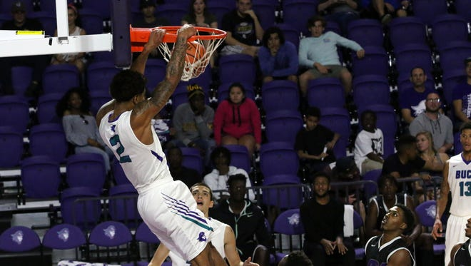 Tremell Murphy dunks during FSW's home game against ASA College on Wednesday, Dec. 7, 2016 at Suncoast Credit Union Arena.