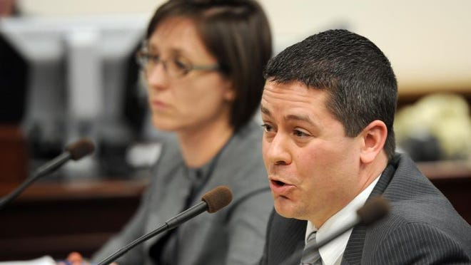 Steve Yeager with the Las Vegas public defender's office, foreground, and Vanessa Spizola with the ACLU both testified against the bill known as Brianna's law that would require DNA testing of all felony arrests.
