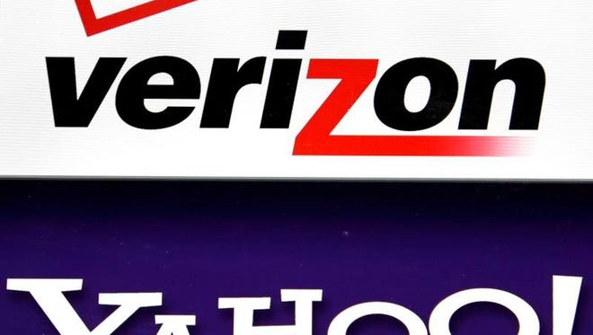 This Monday, July 25, 2016, file photo shows the Verizon and Yahoo logos on a laptop, in North Andover, Mass. Verizon is buying Yahoo in hopes of challenging Google and Facebook in the digital advertising market by combining ad technologies and user profiles from Yahoo and the AOL business it already owns. But Google and Facebook are so much better at this that it'll be tough for Verizon to do more than tread water.